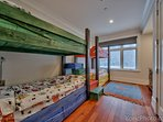 Fun bunkroom for four by the Family Room.  Each bed has a reading light and personal storage