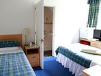 Twin en-suite. 2 single beds with bathroom and shower. Sleep 1 or 2