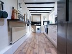 Fully fitted kitchen with American fridge freezer and washing machine