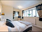 Master Bedroom with En-suite with stunning views over the gardens, lake and Yorkshire Moors