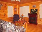 The Great Room has a queen sleeper sofa, electric fireplace, flat screen TV/DVD