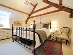 The master bedroom, with beautiful oak beams