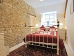 Second double bedroom, with exposed Cotswold stone walls