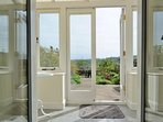 Double French doors to the conservatory and garden