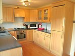 Well equipped kitchen with door to the garden