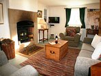Cosy living room with large log burner