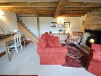 The first living room, with log burner
