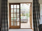 ...with doors opening into the conservatory
