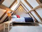 ...with a further single bed, cosily tucked away in the eaves