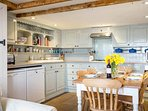 A beautiful, farmhouse style kitchen diner