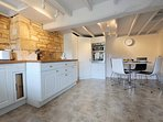 A stylish and bright kitchen and dining room