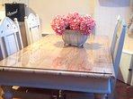 Large, hand painted dining table and chairs