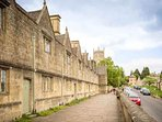 View past almshouses towards St James'; church