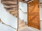 Up the steep, spiral stairs to the master bedroom suite