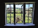 The leaded window on the landing, looking out over the garden