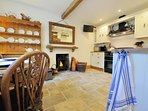 The beautiful kitchen, with a cosy wood-burning stove