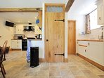 The open-plan kitchen are leads into a handy utility room
