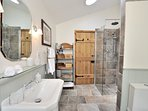 The family bathroom , with a walk-in shower, toilet, wash basin and a heated towel rail