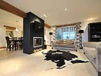 Stylish and elegant, open plan living room with feature fireplace