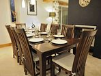 Dining table by the fire with seating for 8