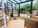 The sun room, perfect for whiling away an afternoon!
