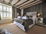 A magnificent, designer bedroom with a king size bed