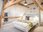 The magnificent master bedroom with A-frame beams
