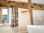 The luxurious ensuite bathroom, with feature freestanding bath