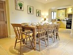 Open plan kitchen / breakfast room, with a large wooden table, seating 8