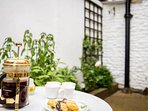The small courtyard garden is ideal for a relaxing coffee or glass of wine!