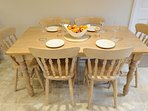 The dining table seats up to 6 people