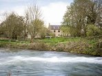 The stunning River Windrush flows past the cottage