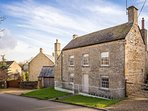 Woodbine Cottage is a beautiful, grade II listed Cotswold stone property