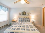Upstairs sailboat-themed bedroom with queen-sized bed