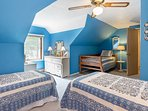 Upstairs kid's bedroom with three twin-sized beds