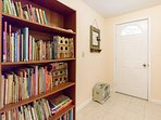 Bookcase downstairs filled with endless activities