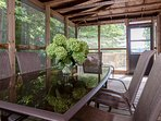 Screened-in porch with plenty of room for family dining