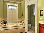 The ensuite master bath features a marvelous soaking tub.