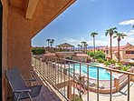 Relax on your private upstairs balcony overlooking the community pool.