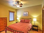 The second bedroom offers a comfortable queen bed.