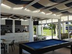 Enjoy a refreshing drink and a game of pool at the poolside bar