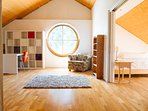 Spacious and fun playroom, opening onto another one of the second floor bedrooms