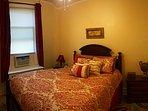 Queen size bed in bedroom #2.