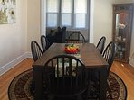 Dining room table can accommodate 6-8 people.