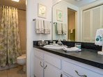 Separate bath and vanity area