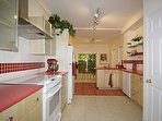 Large bright kitchen equipped for all your cooking or take-out needs! Coffee, tea, etc. & laundry