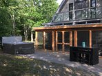 screened in porch and hot tub