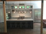 kitchen with granite counters and polished concrete floor