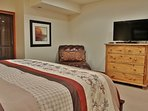 Master bedroom with king bed and 32' HD TV in Silver Cliff - Park City
