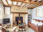 Beautiful, warm living room with log burner